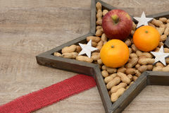 Nuts, oranges and apple Royalty Free Stock Photography