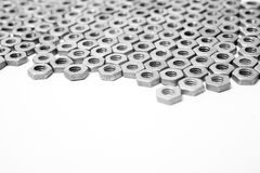 Nuts in an organized array pattern on white Stock Photo