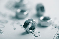 Nuts over technical drawing stock photo