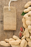Nuts peanuts fruit and tag price on wood Stock Photography