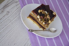 Nuts pie. Chocolate cake with almonds and walnuts royalty free stock photography