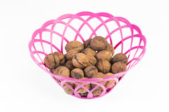 Nuts. Plastic basket with homemade nuts stock image