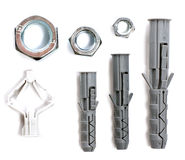 Nuts and plastic parts dowels Stock Image