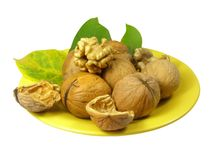 Nuts on the plate royalty free stock images