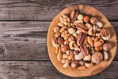 Nuts on plate above stock images