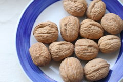 Nuts on the plate Royalty Free Stock Photos