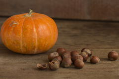 Nuts and pumpkin on a wooden background. Close up stock image