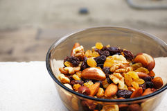 Nuts and raisins Stock Images