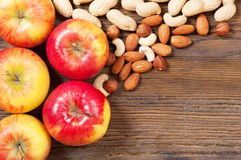 Nuts and red apples Stock Image