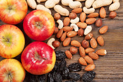 Nuts and red apples Stock Photography
