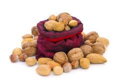 Nuts in sack Stock Images