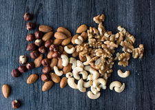 Nuts scattered on black background Royalty Free Stock Image