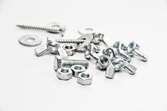 nuts, screw, wing nut, flat washers on a white bac Royalty Free Stock Image
