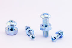 Nuts, screws and washers isolated on white Stock Photo