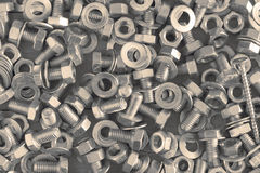 Nuts, screws and washers. Picture of some nuts, screws and washers on a wooden surface Stock Image