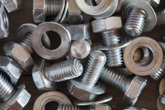 Nuts, screws and washers. Picture of some nuts, screws and washers on a wooden surface Royalty Free Stock Image
