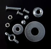 Nuts, screws, washers. Of stainless steel Stock Images