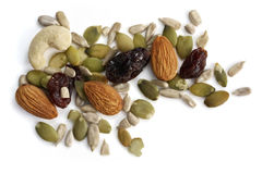 Nuts and Seeds. Trail mix of nuts, seeds, and dried fruit.  Healthy snacking, isolated on white Royalty Free Stock Images