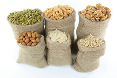 Nuts and seeds in burlap bags. royalty free stock images