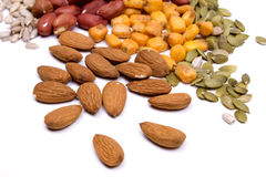 Nuts and seeds, healthy snack. Isolated on white Royalty Free Stock Photo