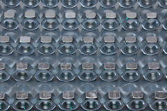 Nuts on sheet surface. Nuts on metal sheet surface Stock Photos