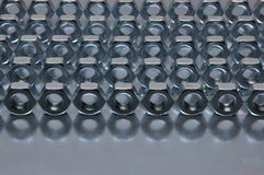 Nuts on sheet surface. Nuts on metal sheet surface Royalty Free Stock Photography
