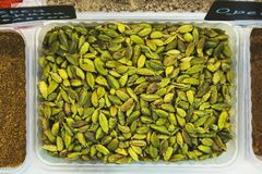 Nuts in the shell on the counter of the grocery market. Harvest nutritious nuts in the store. Vegetarian healthy diet. Nuts of pistachios without shell on the royalty free stock photo