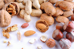 Nuts in shell and shelled on a table top view Stock Image
