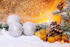 Nuts and silver balls Royalty Free Stock Images