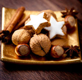 Nuts, spices and cinnamon cookies Stock Photography