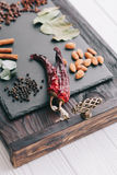 Nuts, spices and food. On a wooden tray Stock Photo