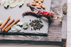 Nuts, spices and food. On a wooden tray Royalty Free Stock Photography