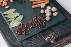Nuts, spices and food. On a wooden tray Royalty Free Stock Photo