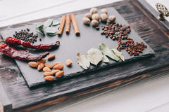 Nuts, spices and food Stock Images