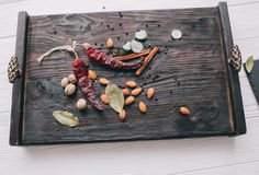 Nuts, spices and food. On a wooden tray Royalty Free Stock Photos