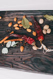 Nuts, spices and food. On a wooden tray Stock Photos