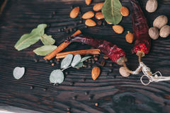 Nuts, spices and food. On a wooden tray Stock Image