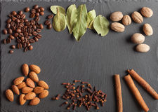 Nuts, spices and food on a wooden tray. Nuts, spices and food on a shate board Royalty Free Stock Image