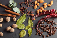 Nuts, spices and food on a wooden tray. Nuts, spices and food on a shate board Stock Images