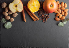 Nuts, spices and food on a wooden tray. Nuts, spices and food on a shate board Stock Photography