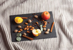 Nuts, spices and food on a wooden tray. Nuts, spices and food on a shate board Royalty Free Stock Photos