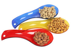 Nuts in spoons Royalty Free Stock Photos