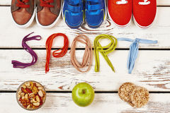 Nuts, sport footwear and shoelaces. Stock Photos