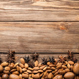 Nuts and star anise on wooden background. Top view. Nuts and star anise on autumn wooden background Stock Photos