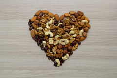 Nuts on the table in a heart shape. Top view Stock Photography