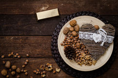 The nuts on toelke on wooden floor Royalty Free Stock Images