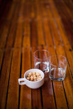 Nuts and two glasses on the bar outdoors Stock Photos