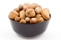 Nuts, walnuts, hazelnuts, almonds. Mixed, isolated on white background Royalty Free Stock Images