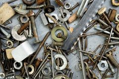 Nuts, washers, bolts, screws of various sizes and shapes over the plain background. A set for the mechanic. royalty free stock photography