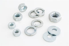Nuts and washers. On a white background Royalty Free Stock Images